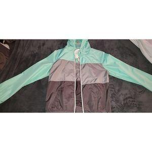 Teal windbreaker jacket